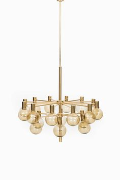 Hans-Agne Jakobsson Ceiling Lamps in Brass and Glass | From a unique collection of antique and modern chandeliers and pendants at https://www.1stdibs.com/furniture/lighting/chandeliers-pendant-lights/