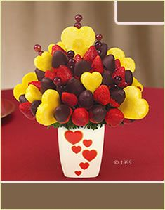Edible Arrangement... Bought this for my hubby at school along with ballons, chocolate covered apples and a teddy bear- Just Because it was Monday (^_^)*