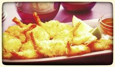 Eating coconut shrimp while looking at hot, sweaty guys surfing; will this day get any BETTER!?