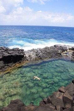 Queen's Bath, Princeville, Kauai Island, Kauai county, Hawaii. This salt water pool is considered dangerous in the winter season with high surf. Seven people drowned after being swept of the rocks by unexpected waves. https://www.google.ca/maps/place/Queen%27s+Bath/@22.2237355,-159.494394,15z/data=!4m5!3m4!1s0x795476a11876130b:0x7f6f89de06cda6de!8m2!3d22.2290762!4d-159.4874403
