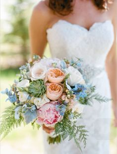 Peach garden roses, pale pink peonies, sagey succulents and light blue delphinium! The perfect bouquet!!!
