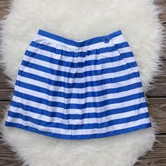 """Lilly Pulitzer Mimosa Skirt Good condition Lilly Pulitzer Mimosa Skirt in blue and white awning stripes. Elastic back waist, pockets. Size XS. Has 3/4"""" stain on back. 26"""" waist, 15"""" long. No trades, offers always welcome. Lilly Pulitzer Skirts Mini"""