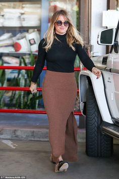 Gorgeous: Newly single Hilary Duff looked effortlessly chic as she was seen picking up her...