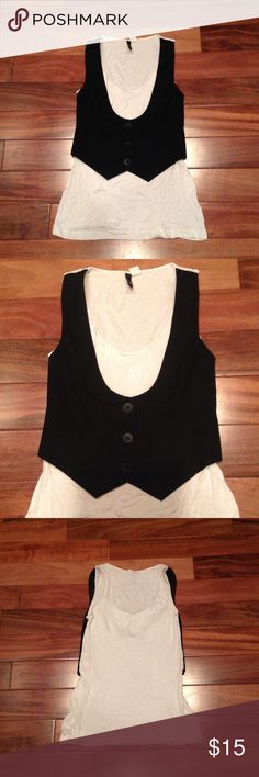 H&M vest t-shirt Size 6. Black and white. 3 buttons and 2 faux pockets on vest. T-shirt is soft and slinky. Body: 96% rayon and 4% spandex. Upper front part: 62% poly, 33% rayon and 5% spandex. Lining: 100% poly. In great condition. Feel free to ask me any questions😊 H&M Tops