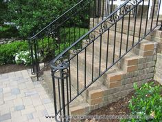 front porch with wrought iron railings More More