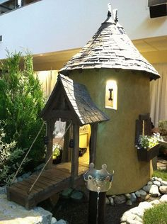I would change the design but love the idea of having a drinking fountain in the backyard! -- The Ultimate Luxurious Dog Houses