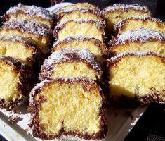 Εξαιρετικό,υπέροχο αφράτο Κέικ βουτηγμένο σε σοκολάτα και καρύδα !!!