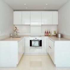 Love looking for great white kitchen decorating ideas? Check out these gallery of white kitchen ideas. Tag: White Kitchen Cabinets, Scandinavian, Small White Kitchen with Island, White Kitchen White Witchen Countertops New Kitchen, Kitchen Decor, Kitchen Ideas, Kitchen Small, Kitchen Modern, Modern Ovens, Modern Room, Modern Small Kitchen Design, Modern White Kitchens