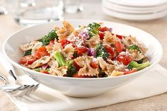 Ripe vegetables and whole wheat noodles get together for a better-for-you take on pasta salad.