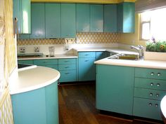 Incredible 1950s steel kitchen cabinets - Love the color!