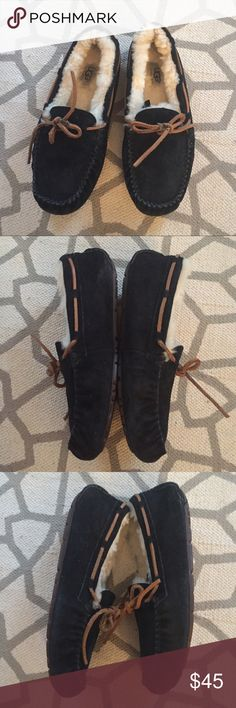 Ugg Black Dakota Slipper Very nice pre-owned condition. Black suede with shearling lining.  The laces have turned a little black where the know but overall very nice. Soles are super clean. UGG Shoes Slippers