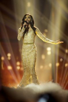 Who is Conchita Wurst?: Photo Meet Conchita Wurst, the bearded drag queen who just was crowned the winner of the 2014 Eurovision Song Contest! The singer represented the country… Conchita Wurst Eurovision, Ruth Lorenzo, Eurovision 2014, Austria, Old Singers, Its A Wonderful Life, Transgender, Frocks, Amazing Women