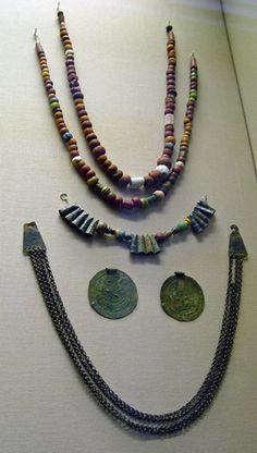 Viking age / ,Sweden,Gotland,Grötlingbo)Beads, sixty-six; 54 monochrome glass; 5 polychrome glass; 1 melon; 3 fossils.