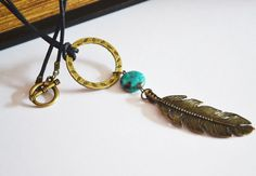 Agate, brass feather