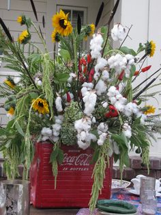 Cotton and sunflowers...love the coca cola cooler container
