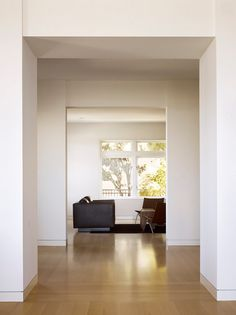 John Maniscalco Architecture flushed recessed baseboard detail, minimalist white walls and wood floor | Remodelista