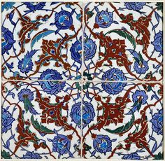 Panel of four tiles of glazed grey fritware, painted in colours on a white slip, Iznik, Turkey, 1560-90.