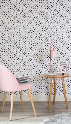 Add girly charm to your living room spaces with this speckle wallpaper design. The simple monochrome palette makes it easy to style. Pair with pink and copper accents for a girly chic that works wonderfully in modern home offices.
