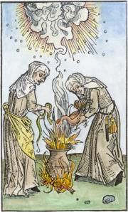 Alchemy:  Woodcut of two witches from Ulrich Molitor, 1508.  An Alchemy artwork.