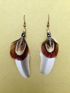 Dangling feather earrings by HFCO on Etsy, £10.00 SOLD