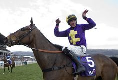 Davy Russell celebrates winning the RSA Chase