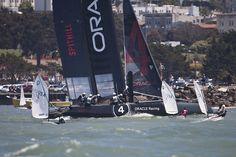 Opti sailors racing the Oracle boat!