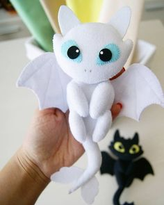 Handmade Light Fury Toy. The height of the toy is 9.5 inches. Material felt, filler synthetic fluff.