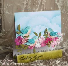 handmade card ... clear acetate cover ... three awesomely beautiful birds made using the two-step bird punch ... lovely flowers and a cloudy blue sky background ... WOW!!!Stampin' Up!