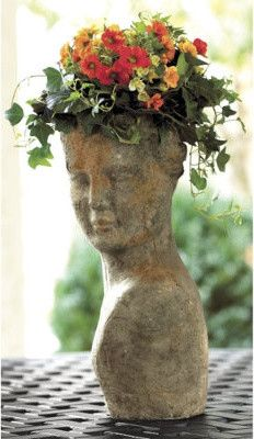 terra cotta lady planter that covers in moss over time... PERFECT for Seattle gardens. If I were still there.