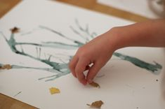 Fall Tree. Make a tree by blowing water colors through a straw. Then glue pieces of dried leaves on top.