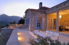 This Greek villa has that Mediterranean/Tuscan/Provence look that is so timeless...