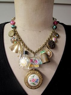 Made from vintage vanity items - compact, thimble, perfume bottle. $149.00