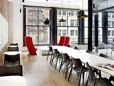 The Japan fashion giant Uniqlo open its North American headquarters in a SoHo loft space in NYC.