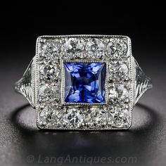 Art Deco Sapphire and Diamond Ring, masterfully handcrafted in platinum, circa 1920s, adazzle with one carat of bright-white and sparkling European-cut diamonds, has been revivified with a modern-cut, and especially lively, electric blue, faceted square sapphire weighing 1.30 carats. The beveled sides and tapered shoulders of the ring are elegantly and thoroughly adorned with decorative hand engraving. Fine milgraining adds the finishing flourish to this bright and smiling Art Deco delight.