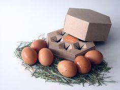 Hexovo (Salvador Bru, 2010): The eggs will be presented in an eggcup of cardboard recycled with form of hexagonal prism. This format search to recall us to a nest, intends to give a traditional and more austere image to the presentation of the product.