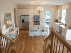 *white oak hardwood flooring (fruitwood stain) *solid maple cabinets (custom color) *quartz countertops (ivory coast) *stainless appliances *pewter hardware (Thomasville) *antiqued silver and crystal chandeliers *paint colors:  White Sand by Benjamin Moore Trim, Dove Wing by Benjamin Moore