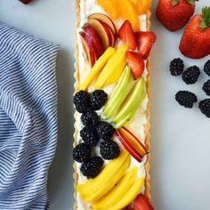 A beautiful Spring dessert featuring a flaky, buttery crust filled with homemade vanilla bean cream and topped with sliced fresh fruit.