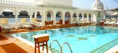 Taj Lake Palace - the stunning main pool overlooking the lake, with original style sun-loungers!