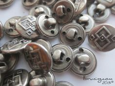 metal buttons are conductive and can be used as switches in eTextile, craft-tech and wearable computing.  (april 2013)