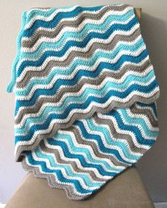 Add some waves to the nursery with this ripple blanket! {Link to shop in profile} . . . . . .  #linkinbio #etsy #etsyseller #etsyshopowner #shop #gift #yarnlove #crochetaddict #crochet #yarnaddict #hookandcable #instacrochet #crochetersofinstagram #shopetsy #shophandmade #etsyfinds #etsystore #etsyhandmade #chevron #ripple #blanket #coolwaves #babyblanket #baby #babyboy #babyboy #stripes #striped #teal #turquoise #blue by hookandcable