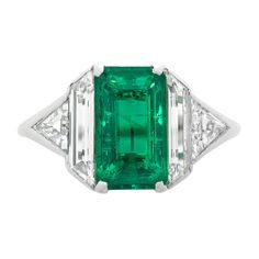 Art Deco Emerald Diamond Platinum Ring   From a unique collection of vintage engagement rings at https://www.1stdibs.com/jewelry/rings/engagement-rings/