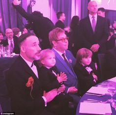 Family affair: Elton John and David Furnish watched the show with their sons at their annual Oscar viewing party. 'The boys stop by for a visit in the sweetest little black tie dinner suits. They are so happy to see Uncle Neil on the big screen!! (sic)' Elton captioned an Instagram picture of his modern family.