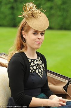 Princess Beatrice, not always known for making good choices when it comes to headgear, struck an elegant note today with a small, straw-coloured hat