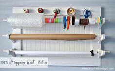 Homemade wrapping wall station tutorial by Inspirations by D ~ Thinking about adding one to my sewing room, but all retail ones look so bulky and heavy.  Only concern I have about this is making it...