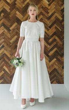 Elegant ankle length wedding dress with 3/4 length sleeves by Andrea Hawkes