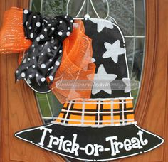 This witches hat will show the whole neighborhood you are ready for trick or treaters!   The stars are painted in metallic silver, the band on the hat is plaid with silver ribbon embellishment.   Cut from high quality wood, hand-painted and sealed with gloss finish for indoor/outdoor use to protect against the elements. Back of door hanger is painted white and includes wire hanger.