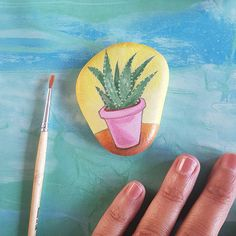 Pebble art cactus miniature hand painted sea rock with aloe vera plant by Claudia Nanni Fine Art #cactus #aloevera #pebble #homedecor #summer #etsy