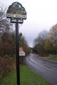 West Malling Village Sign I am very lucky to be living in the lovely Kings hill, west Malling Maidstone. I spent a lot of years living on my own with my girls in Wales. At last I am living with my husband so we can be a family all together. Leonard Street, England Countryside, English Village, Decorative Signs, Street Furniture, Place Names, Sign Design, Country Life, Geography