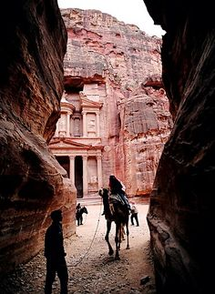 A camel balks at the entrance to Petra's Siq, a narrow gorge over 1km long. Behind looms the Al-Khazneh (Treasury), originally an early 1st-century tomb of an important Nabataean king. Image by www.amandacastleman.com.
