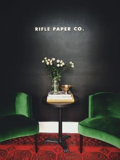 Dark walls and velvet chairs at Rifle Paper Co